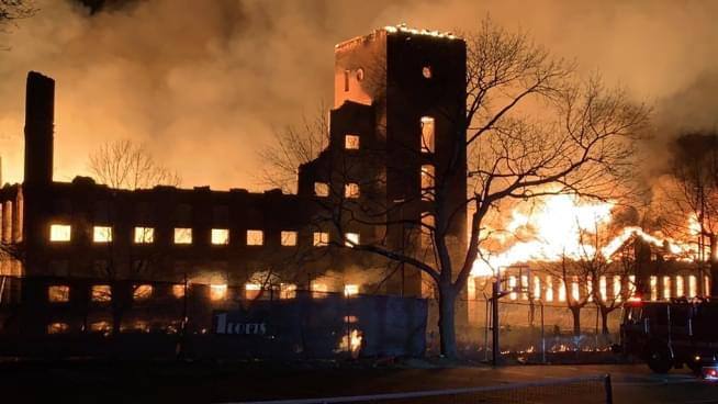 Mill fire rages on Central Falls – Pawtucket line