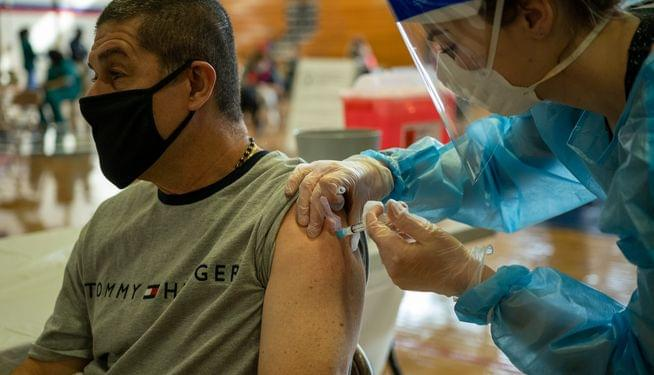 2 hard-hit cities, 2 diverging fates in vaccine rollout