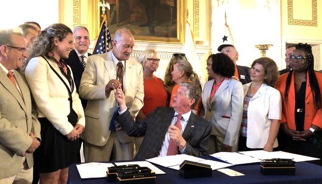 RI gov signs gun safety laws, including school firearms ban