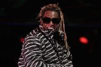 Trump grants clemency to rappers Lil Wayne and Kodak Black in final flurry of presidential power
