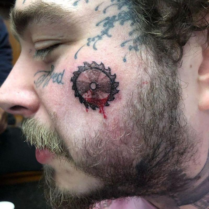 Post Malone Shows Off Latest Face Tattoo of a Bloody Saw Blade