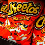Woman arrested after being linked to crime via Cheetos residue on teeth (VIDEO)