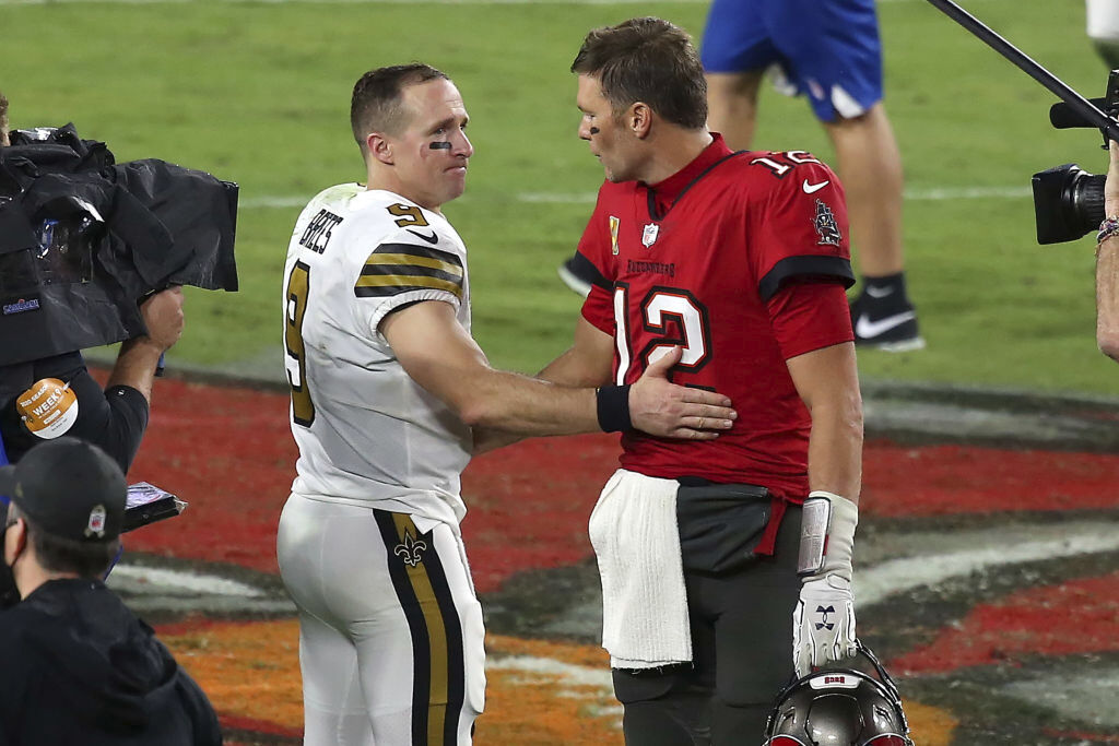 Tom Brady and Drew Brees share a moment