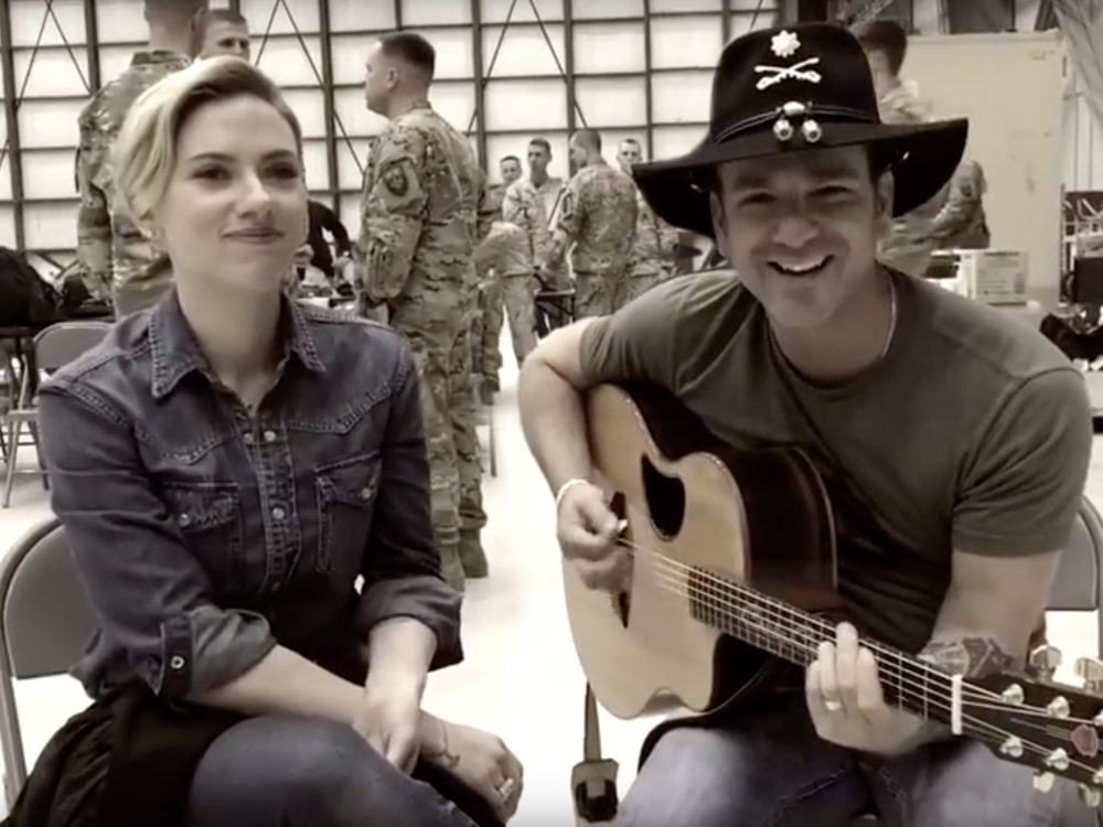 """Watch Craig Campbell and Actress Scarlett Johansson Sing """"These Boots Are Made For Walkin'"""" During USO Tour in Afghanistan"""