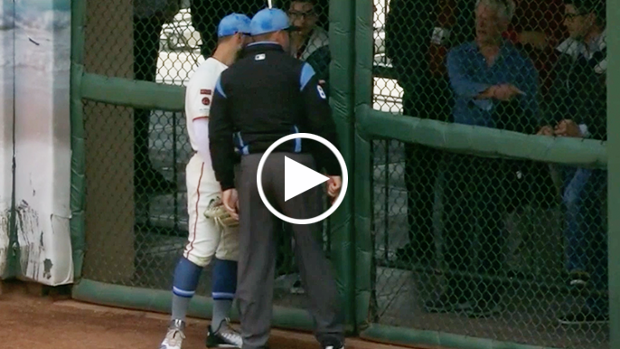 Ball somehow squeezing through outfield fence saves Giants a run