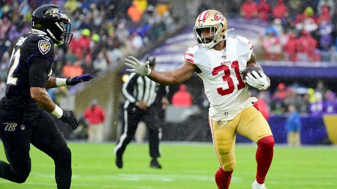 Running in the rain: Ravens outlast 49ers in ground game slugfest