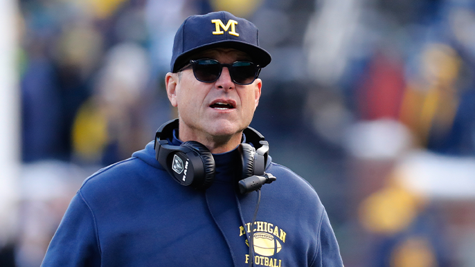 Jim Harbaugh wants to play in fall: 'We will not cower from (the virus)'