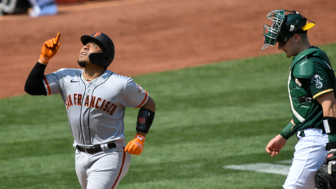 Giants go wild and keep pace in wild-card chase with destruction of A's