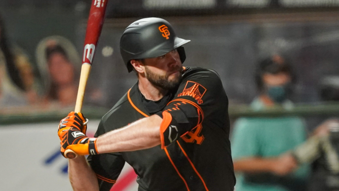Giants' bats awaken with first two homers of the spring