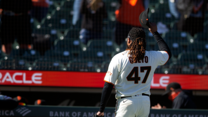 A triple shimmy, a booed manager: Johnny Cueto's home opener had it all