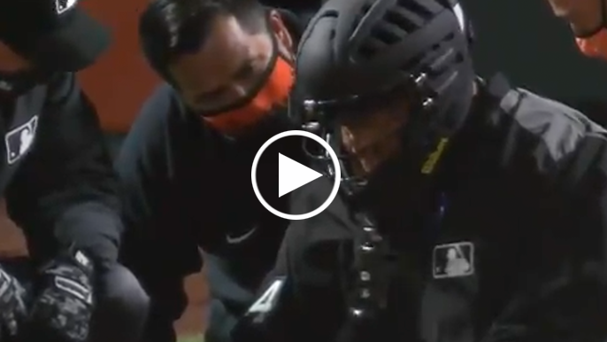 Giants-Rockies home-plate umpire goes down in scary moment