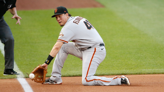 Giants' pitching saves sleepy bats in odd, extra-inning escape