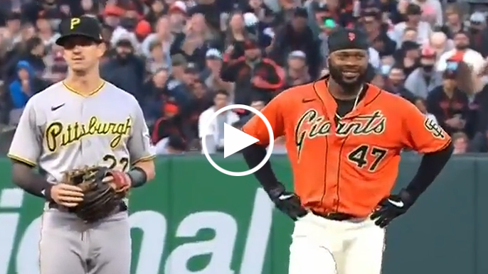 Johnny Cueto can't help smiling after first career stolen base
