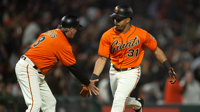 Solano sends it to extras, Gausman drives in winning run in 6-5 win over Braves