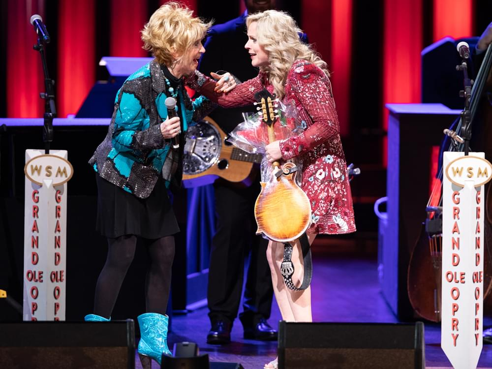 Watch Jeannie Seely Surprise Rhonda Vincent With Invitation to Join the Grand Ole Opry