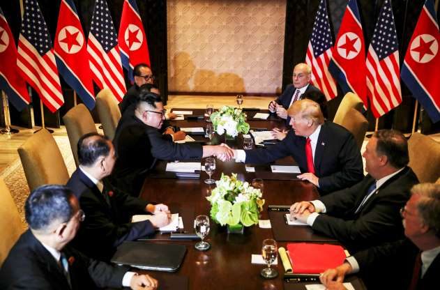 Trump, North Korean leader Kim Jong Un sign unspecified document in Singapore