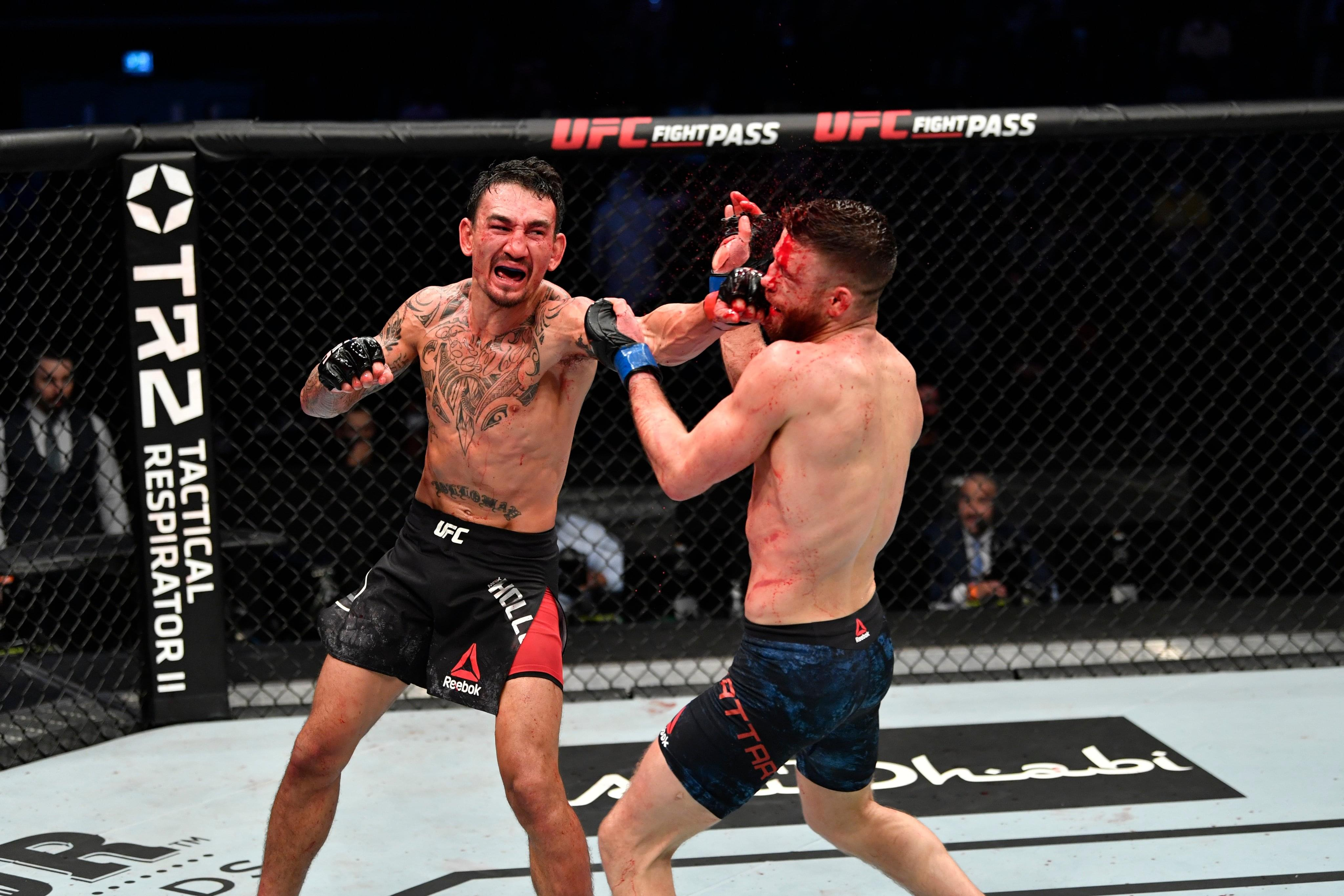 Local athletes and more react to Holloway's dominant performance