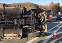 [VIDEO] Wood chip truck overturns Wednesday morning