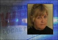 Woman charged in July 12 wreck