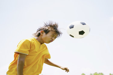 Kid Heading Soccer Ball
