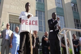Community joins at vigil for peace, love and unity (Video)