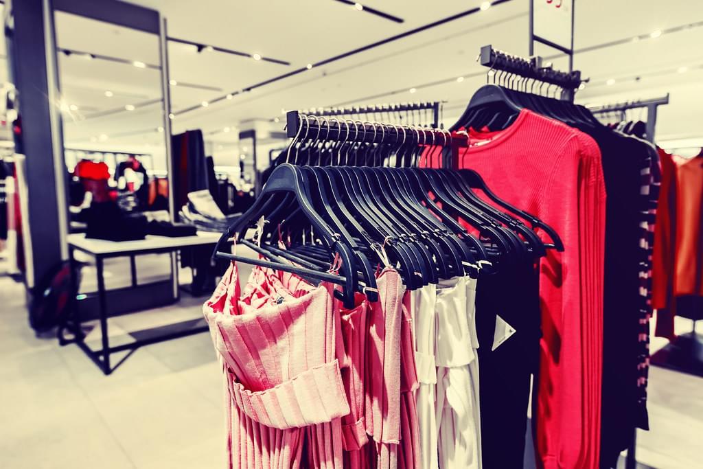 Women clothes in fashion store. Shopping mall. Women fashion sho